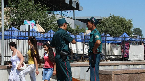 Police guard the entrance to the Chrosu subway station in Tashkent in September. [Maksim Yeniseyev]