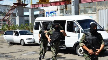 National Security Service (SNB) personnel carry out an operation in Tashkent Province June 26. [Unus Latip]
