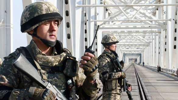 Uzbekistani border guards patrol the Druzhba (Friendship) bridge that spans Uzbekistan and Afghanistan in the spring of 2016. [Uzbek Ministry of Foreign Affairs]