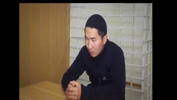 "Abdusalam Murzubayev, a resident of Ekibastuz, Pavlodar Province, is shown in pre-trial detention. He received a seven-year sentence in March 2014 for fighting in Syria. [Screenshot from the video ""The Syrian Trap""]"