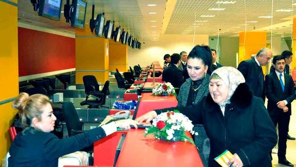 The first passengers register on the Dushanbe-Tashkent flight at Dushanbe International Airport, February 10. [Tajik news agency Khovar]