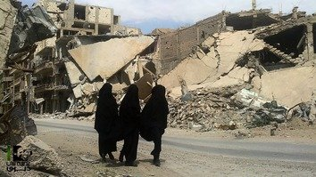 Tajik women in Syria, many of whom were taken there against their will, are shown here in December. [Twitter]