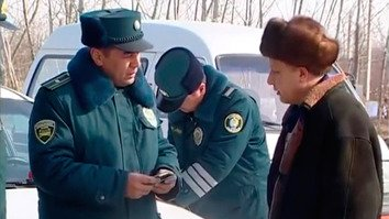 Traffic police check a motorist's documents in Namangan Province March 3. [TV screenshot]