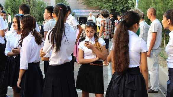Children wait outside High School No. 18 in Tashkent last September before the first day of the school year. Authorities are concerned about the potential link between truancy and radicalisation. [Maksim Yeniseyev]
