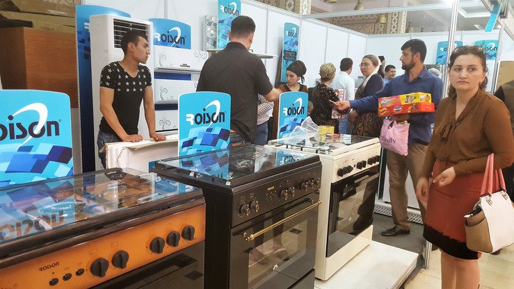 An Uzbekistani firm displays electrical stoves in Dushanbe April 20. [Nadin Bahrom]