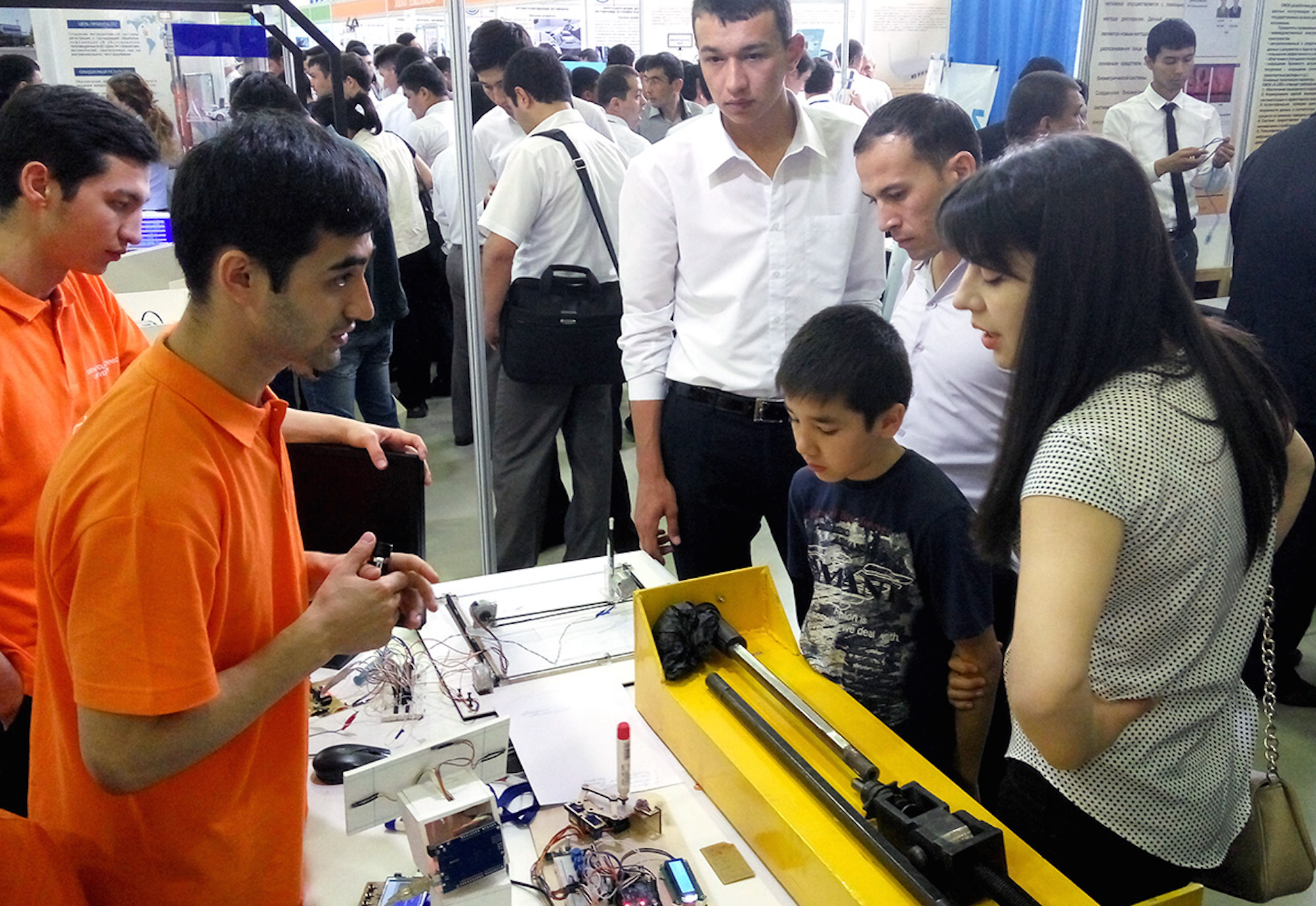 Students at Inha University in Tashkent demonstrate the robots that they made at a Tashkent exhibition May 13, 2016. [Maksim Yeniseyev]