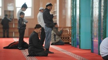 Mosque-goers pray in Astana in March. [Ksenia Bondal]