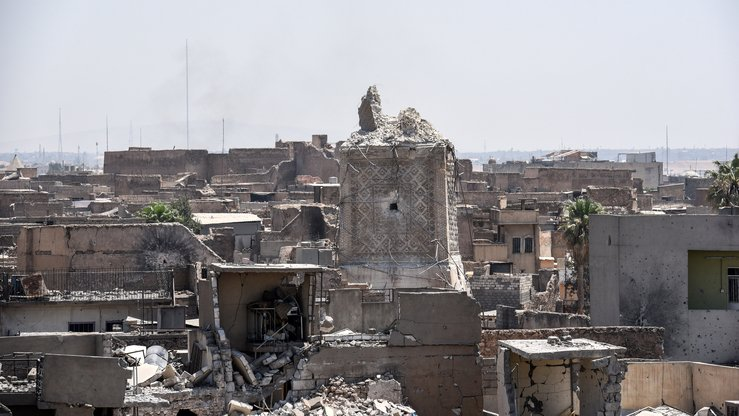 "A picture taken on June 25, 2017 shows Mosul's destroyed ancient leaning minaret, known as the ""Hadba"" (Hunchback), in the Old City after being blown up by IS fighters earlier in the week. Mosul's trademark leaning minaret was missing from its skyline for the first time in centuries. [Mohamed El-Shahed/AFP]"