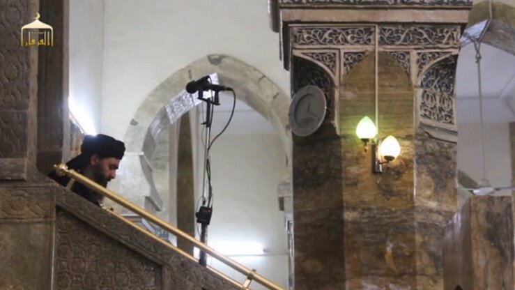 'Islamic State' leader Abu Bakr al-Baghdadi descends from the pulpit of Mosul's al-Nuri mosque after announcing the creation of a 'caliphate' in this screen shot from a June 2104 video.
