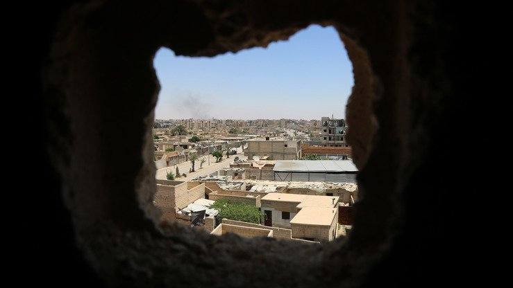 A general view shows the areas under 'Islamic State' control in al-Raqa on June 27th in the suburb of Dariya on the western city limits after the area was seized by Syrian Democratic Forces. [Delil Souleiman/AFP]
