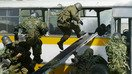 Kyrgyz State National Security Committee (GKNB) troops take over a bus in counter-terrorism exercises 20km outside Bishkek May 23, 2007. [AFP/Vyacheslav Oseledko]
