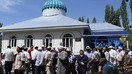 Clergy, government officials and local residents attend the opening ceremony for the Nurdin Ata Mosque in Biymyrza, Osh Province, August 8. [Osh Province Qaziyat]