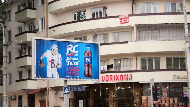An RC Cola billboard stands above a Tashkent street September 29. An RC Cola bottling plant opened in Uzbekistan August 3. [Maksim Yeniseyev]