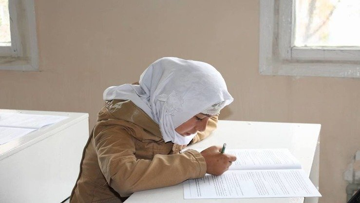 A girl at a madrassa in Jalal-Abad, Kyrgyzstan, studies in September. The all-girls madrassa teaches students professional skills and foreign languages to better prepare them for the future. [Spiritual Administration for Muslims of Kyrgyzstan (DUMK)]