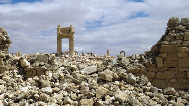 A picture shows on March 29, 2016 the remains of the Temple of Bel in the historical city of Palmyra after it was blown up by the 'Islamic State' (IS). [STRINGER / AFP]