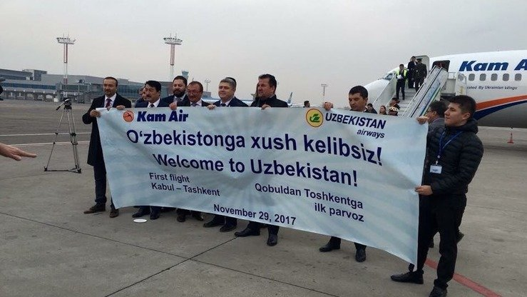 Airline officials November 29 in Tashkent celebrate the first flight by Afghanistan's Kam Air from Kabul to Tashkent.  [Tahir Qadiry/Twitter]