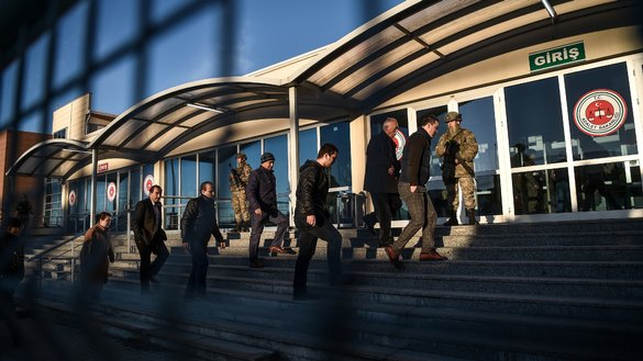 People enter an Istanbul courthouse as Turkish soldiers guard the entrance December 11. It was the opening day of the trial of an Uzbekistani citizen who confessed to killing 39 people at a local nightclub January. Abdulkadir Masharipov faces 40 life sentences. 'Islamic State' claimed responsibility for the mass shooting. [Ozan Kose/AFP]