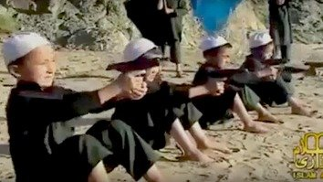 A screenshot of a video shows alleged Kazakhstani children undergoing training at an 'Islamic State' (IS) training camp in Syria. Convicted Kazakhstani militant Nurkhan Seytkali posted the video online in September 2014. [Screenshot by Alexander Bogatik]