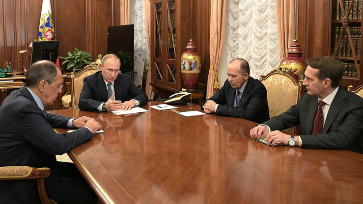 Russian president Vladimir Putin meets with Foreign Minister Sergei Lavrov, Director of the Foreign Intelligence Service Sergei Naryshkin and Director of the Federal Security Service Alexander Bortnikov on December 19, 2016. In a recent interview, Bortnikov said the Soviet state-sponsored executions during the 1930s 'had an objective side to them'. [Kremlin]