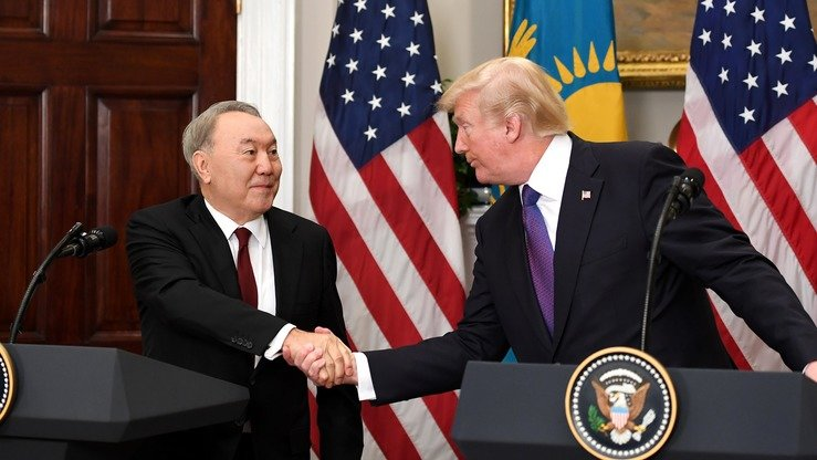 "US President Donald Trump (right) and Kazakhstani President Nursultan Nazarbayev (left) January 16 shake hands at the White House, where they discussed strengthening bilateral co-operation in a number of areas. Nazarbayev's three-day visit was deemed a ""success"" and ""historically important"". [Kazakhstani presidential press office]"