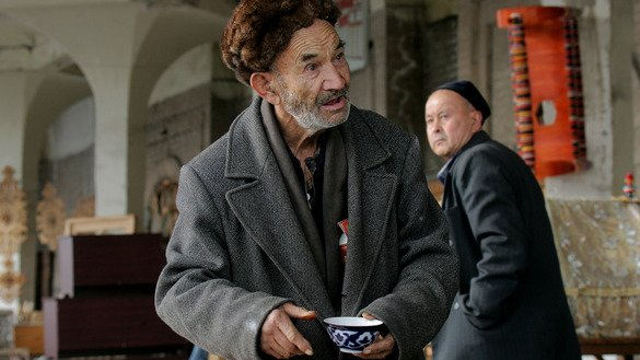 An Uzbek man holds a cup of tea at a tea house in Tashkent in December 2007. Uzbekistan often experiences cold and harsh winters, making a stable heat supply critical for ensuring the well-being of its citizens, says the World Bank. [Maxim Marmur/AFP]