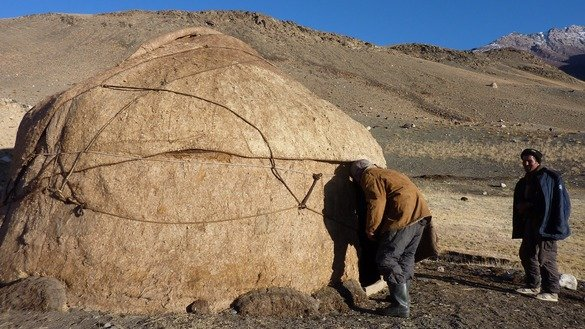 This picture taken last October 10 shows a Kyrgyz boy entering his traditional yurt in the Wakhan Corridor in Afghanistan. [Gohar Abbas/AFP]