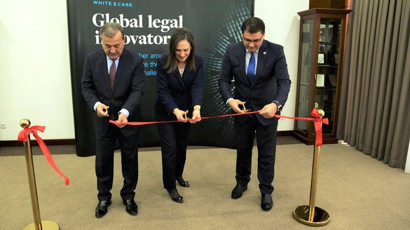 American-Uzbekistan Chamber of Commerce chairwoman and White & Case partner Carolyn Lamm (centre), First Deputy Senate Chairman Sodik Safoyev (left) and Justice Minister Ruslanbek Davletov (right) cut a ribbon at the opening of the White & Case office in Tashkent on January 29. [Uzbekistani Ministry of Justice]