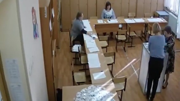 A still from footage from a Moscow polling station on March 18th shows two female campaign workers stuffing the ballot box with what is to be assumed fake votes.