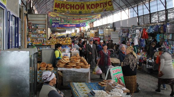 Kazakhstanis shop at the Auyl Bereke Market in Taraz March 6. Kazakhstan's government is working to reduce unemployment and protect the nation's self-employed workers, many of whom work without formal contracts, to prevent exploitation. [Aydar Ashimov]