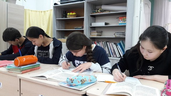 Pupils of Bishkek Public School No. 20 write a composition in March. They are graduates of the US-aided literacy project in Kyrgyzstan. [Asker Sultanov]