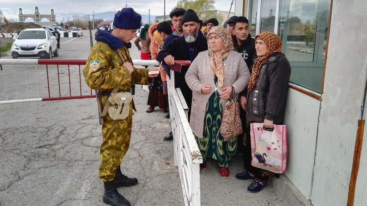 A Tajik border control officer checks documents at the Patar-Adarkhon checkpoint on the Tajik-Uzbekistani border March 15. The US government is helping Central Asian countries to increase border security and prevent trafficking of nuclear materials and WMDs. [Negmatullo Mirsaidov]