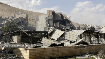 "This picture taken on April 14, 2018 shows the wreckage of a building described as part of the Scientific Studies and Research Centre (SSRC) compound in Barzeh district, north of Damascus, during a press tour organised by the Syrian information ministry. Syrian state news agency SANA reported several missiles hit a research centre in Barzeh, north of Damascus, ""destroying a building that included scientific labs and a training centre"". [Louai Beshara / AFP]"