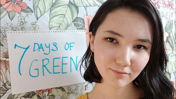 "Anel Amirkenova of Almaty, a contest participant, is shown April 14. One of the challenges was to re-use a sheet of paper by writing the contest name, ""7 Days of Green"", on the other side. [Aydar Ashimov]"
