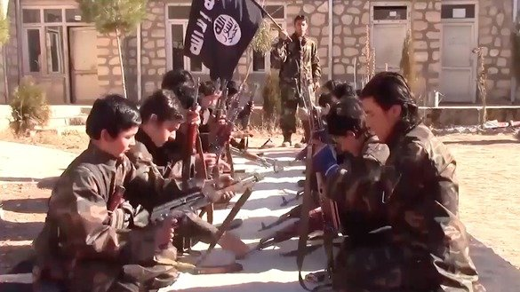 Children undergo arms training in an IS video posted March 4. [File]