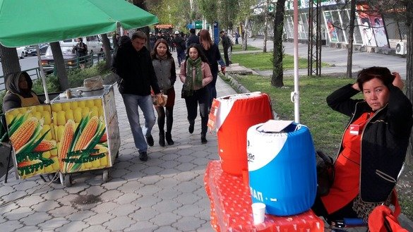 Kyrgyz women sell snacks in downtown Bishkek April 19. A recently launched EU-funded project seeks to change the role of women in Kyrgyzstan across generational and gender borders. [Asker Sultanov]