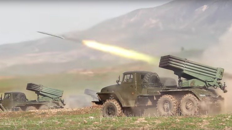 Russian mobile missile launchers fire off their payload in Tajikistan in April. [Russian Ministry of Defence]