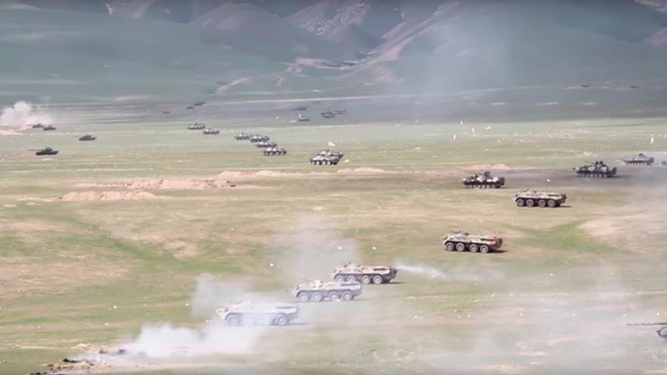 Various Russian tanks and armoured personnel carriers are seen advancing across Tajik territory during a live fire exercise near Harbmaydon in 2017. [Russian Ministry of Defence]