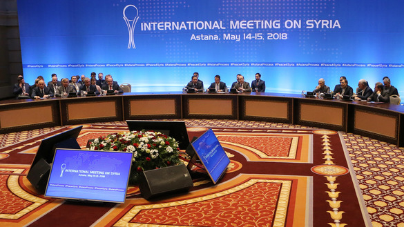 Syrian regime representatives, opposition delegates and other attendees participate in the plenary session of Syria peace talks brokered by Iran, Russia and Turkey in Astana May 15. [Stanislav Filippov/AFP]