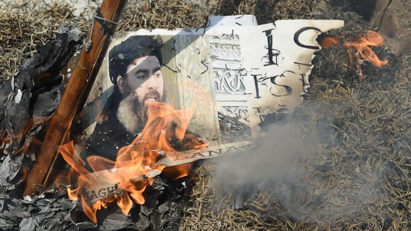 Indian demonstrators burn a poster of 'Islamic State of Iraq and Syria' leader Abu Bakr al-Baghdadi during a protest in New Delhi on June 9, 2017. With most senior IS leaders dead, al-Baghdadi is effectively unable to lead his group. [Prakash Singh/AFP]