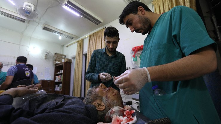 Wounded Syrians receive medical care in Zardana in the mostly rebel-held Idlib Province, Syria, after air strikes in the area late on June 7. Air strikes in northwestern Syria, thought to have been carried out by regime ally Russia, killed 38 civilians including four children, the Syrian Observatory for Human Rights monitoring group said. [Omar Haj Kadour/AFP]