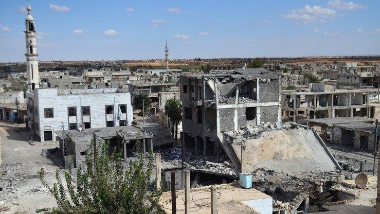 Deserted streets and damaged buildings in Talbisseh, Homs Province, Syria, are shown September 30, 2015. Russia confirmed that day that it carried out its first air strike in Syria, near the city of Homs, marking the formal start of Moscow's military intervention. [Mahmoud Tama/AFP]