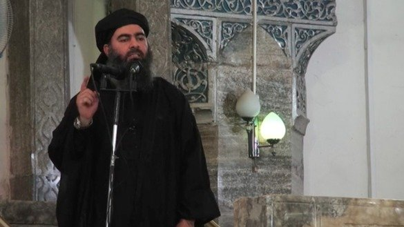 "Abu Bakr al-Baghdadi declares the creation of the ""Islamic State"" at the al-Nuri Mosque in Mosul, Iraq, in 2014. Al-Baghdadi is from Iraq and was part of al-Qaeda before he became the founder of IS. [File]"