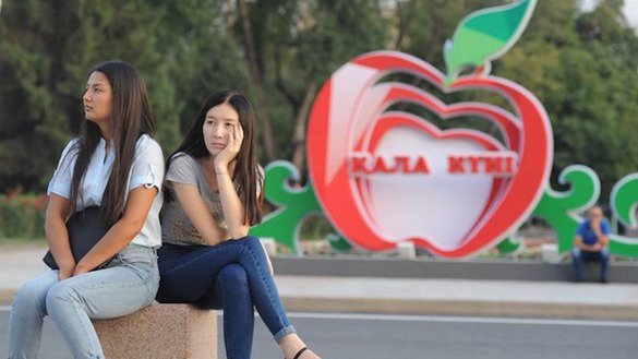 Young women sit in downtown Almaty in May. Studies indicate that about 400 women die as a result of domestic violence every year in Kazakhstan. [Vladimir Tretyakov]