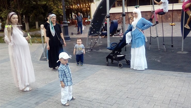 Mothers play with their children in downtown Almaty June 27. There were 91,631 crimes committed against women in Kazakhstan in 2017, according to Soros Foundation-Kazakhstan. [Ksenia Bondal]