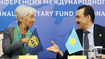 International Monetary Fund (IMF) Managing Director Christine Lagarde (left) and Kazakhstan's then-Prime Minister Karim Massimov greet each other during an IMF regional conference that was part of the Astana Economic Forum May 24, 2016. [Ilyas Omarov/AFP]