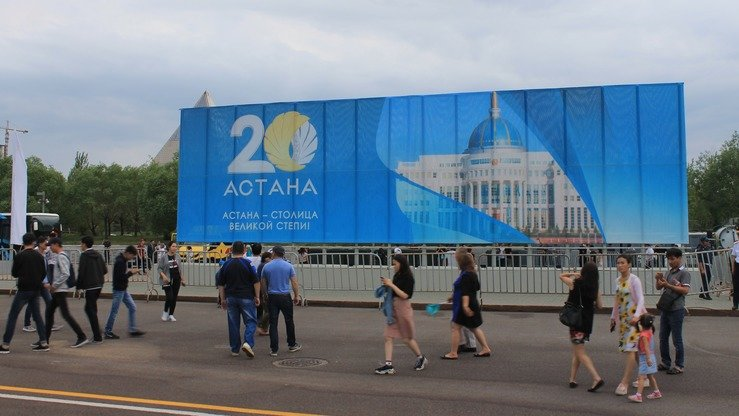 Kazakhs stroll through Astana for the Day of the Capital holiday July 6. [Aydar Ashimov]