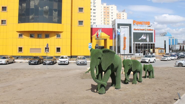 Modern sculptures, such as this family of green elephants, decorate the capital. [Aydar Ashimov]
