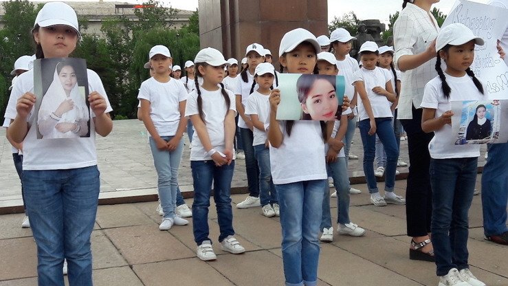Schoolchildren protest bride kidnapping at a rally in Bishkek June 9. They are holding photographs of medical student Burulai Turdaaly Kyzy, who was murdered May 27 by her alleged abductor. [Asker Sultanov]