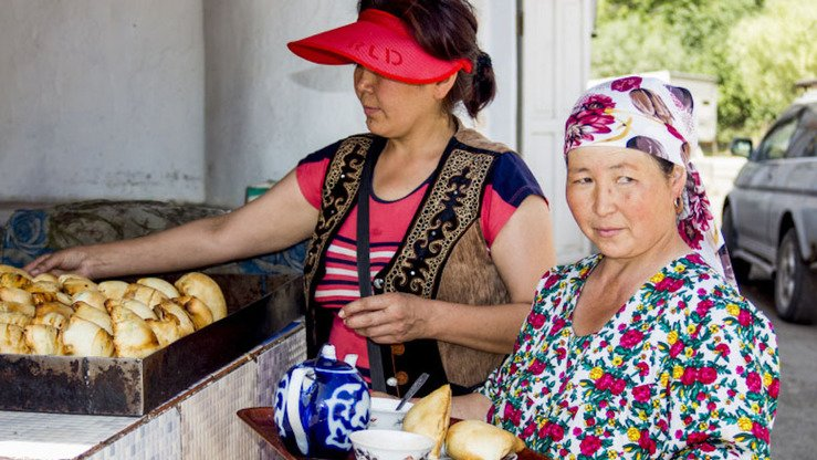 "The Dadabayev family, pictured here, owns a small road café near the Kyrgyz-Tajik border. ""There will be many tourists, if the road is good,"" said Ms. Dadabayeva. [World Bank Group]"