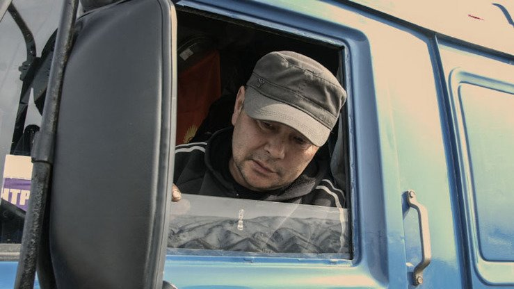 "Asangodjayev, a Kyrgyz truck driver, appreciates the modern technology, like the axle load control, being used on the new roads. ""It's good that the scale is automatic. We pass very quickly, without delay, in less than five minutes,"" he said. [World Bank Group]"